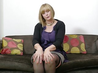 Mature auburn lady April is really into working on say no to wet pussy