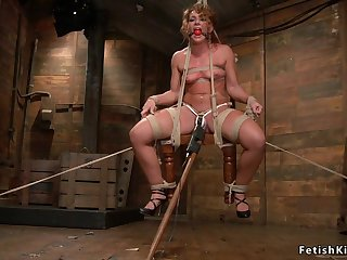 Hogtied darkhaired babe whipped with the addition of tormented