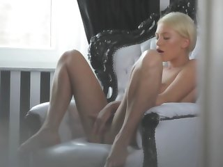 A hot blonde is tweaking her cunt lips with her hands really well