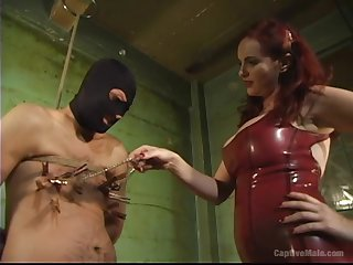 Busty redhead Mz Berlin wants to show her friend what is someone's skin BDSM