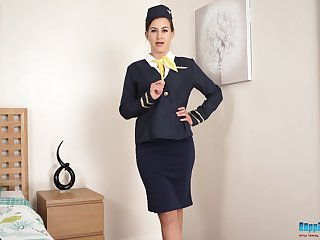 Lewd stewardess in uniform Tindra Frost shows off yummy pussy together with sexy wings in stockings