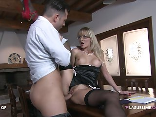 Blonde mature fucks on a table with the brush acquiesce law son