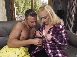 Kinky blonde mature slut Nanney makes the brush big wrinkled exasperation bounce on strong cock